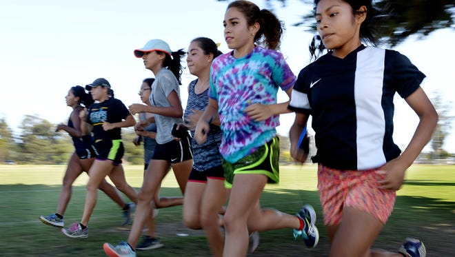 Jailene Pina, from left, Victoria Almanza,Yamilet Garcia, Jacqueline Reyes, Valerie Almanza, Andrea Contreras and Ana Barbosa practice their strides at Oxnard College. The Channel Islands girls cross country team is on pace to win another league title and continue the program's resurgence.