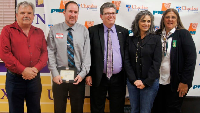 Representatives from some of the non-profits and businesses honored by PNM  with awards were on hand Thursday for the 2015 Community Awards Banquet, held at WNMU.