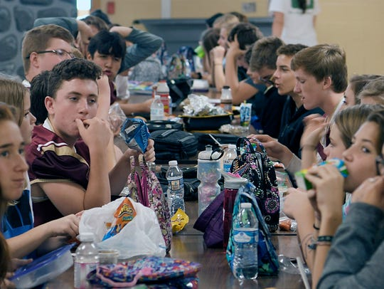 Eight graders at Page Middle School start eating lunch