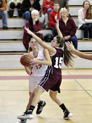 Senior Jess Catalioto, left, and the Lakeland girls' basketball team tipped off the season on Friday night at home against rivals Passaic Valley.
