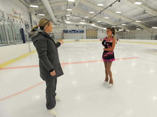 Mia Roberts works with her coach Laura Jamieson of Bear, Delaware, on the routine for her next figure skating competition.