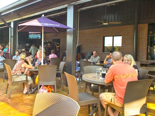 The patio is a favorite place to dine during the summer at Crimson American Grill in Spring Garden Township, with shady umbrellas and a roof overhead.