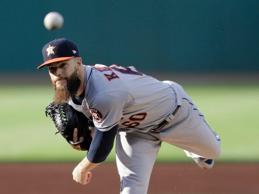 Houston Astros starting pitcher Dallas Keuchel delivers during the first inning of the team's baseball game against the Cleveland Indians, Tuesday, April 25, 2017, in Cleveland. (AP Photo/Tony Dejak)