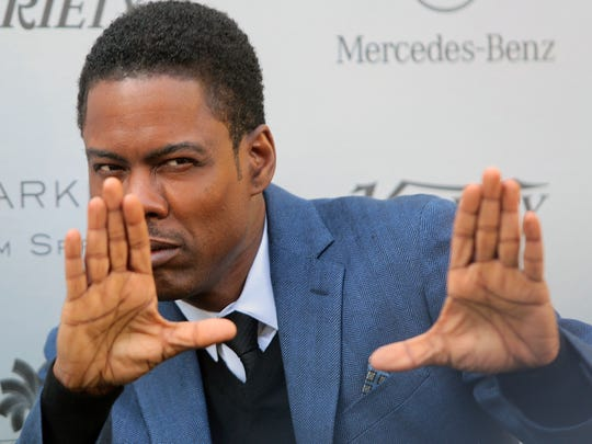 Chris Rock strikes a director's pose as he arrives at the Variety Creative Impact Awards brunch on Sunday, January 4, 2015 at the Parker Palm Springs. Rock received the Creative Impact in Comedy award.