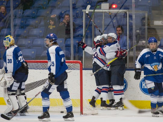 Team USA players, shown celebrating a tournament goal last season against Finland, are sure to bring intensity to USA Hockey Arena for the 2018 Four Nations Cup.