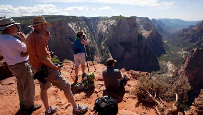 Zion National Park visitors soak up the view from Observation Point Wednesday, Sept. 26, 2012.