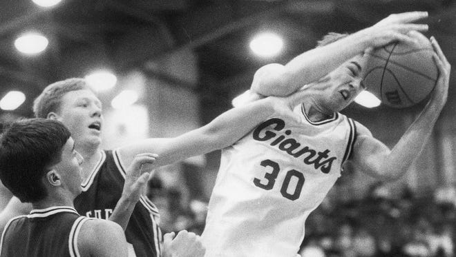 FILE – Mike Brooks of Ben Davis (right) is among the 18 men chosen for the Indiana Basketball Hall of Fame's 2017 Silver Anniversary Team.