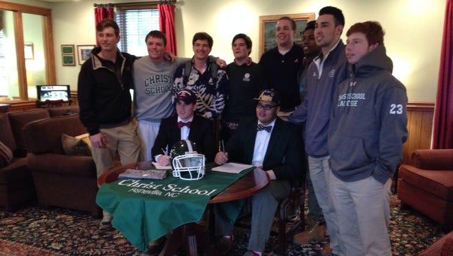 Christ School seniors Landon Archangelo and Malik Johnson signed to play college football on Monday.