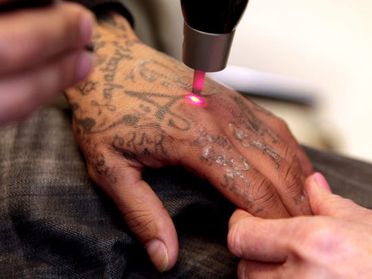 Leroy Turner is having all the tattoos on his hands,