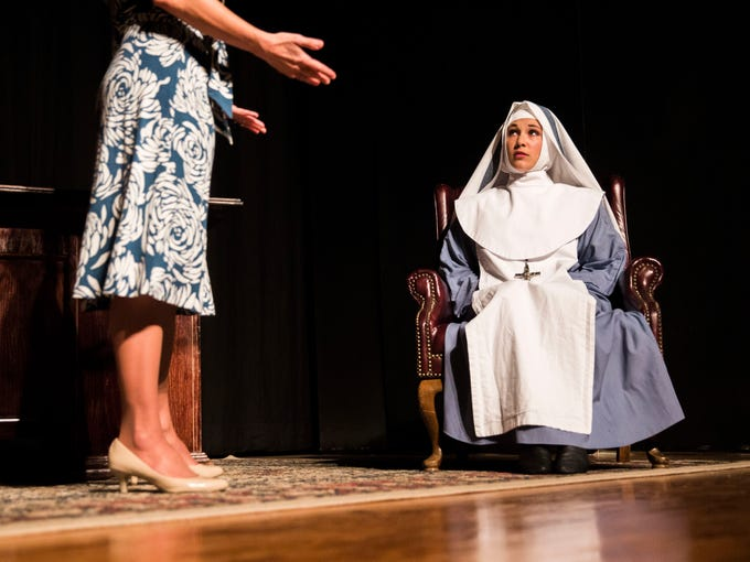 Kathleen Thomas, right, playing Agnes, looks up at