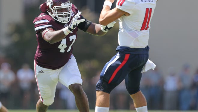 Mississippi State's A.J. Jefferson (47) from Summit pressures South Alabama's JarMarkus Sims (11). Mississippi State played South Alabama in a college football game on Saturday, September 3, 2016 at Davis Wade Stadium in Starkville, MS. Photo by Keith Warren