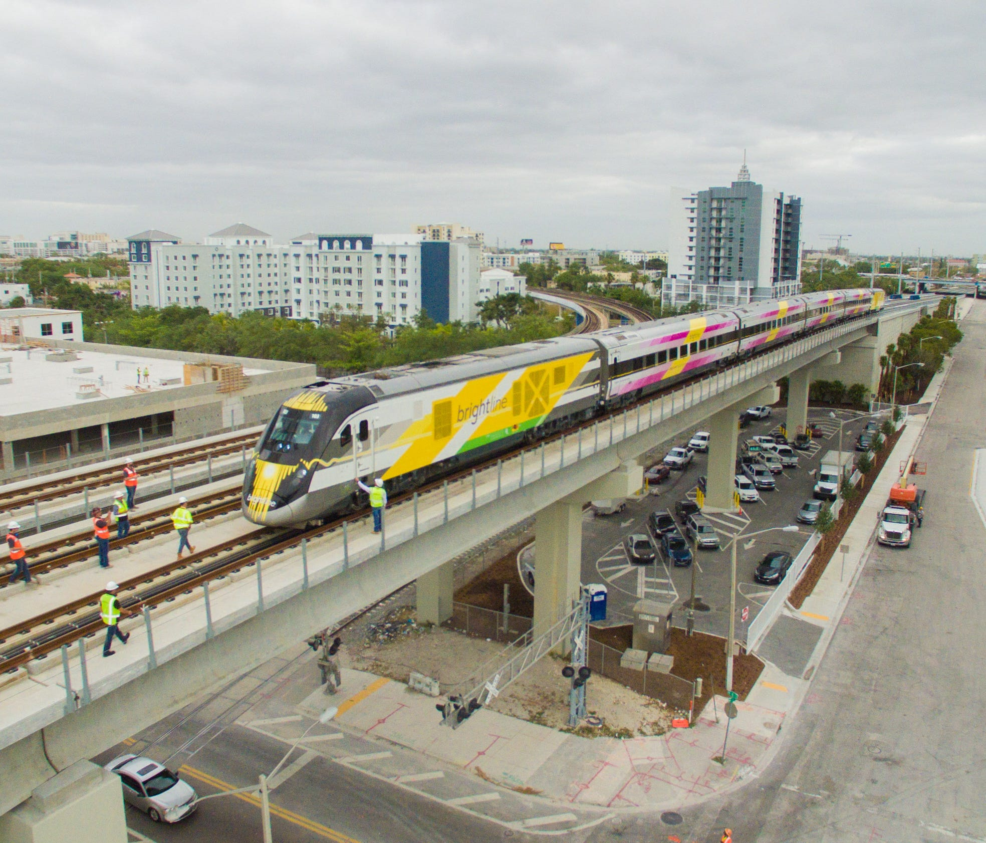 A Brightline train approaches MiamiCentral station.