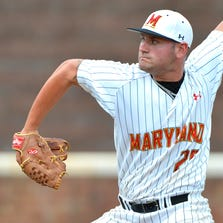 Jun 8, 2014; Charlottesville, VA, USA; Maryland Terps pitcher Tayler Stiles (25) pitches during the seventh inning against the Virginia Cavaliers  at Davenport  Field. against the Virginia Cavaliers  defeated Maryland Terps 7-3. Mandatory Credit: Tommy Gilligan-USA TODAY Sports