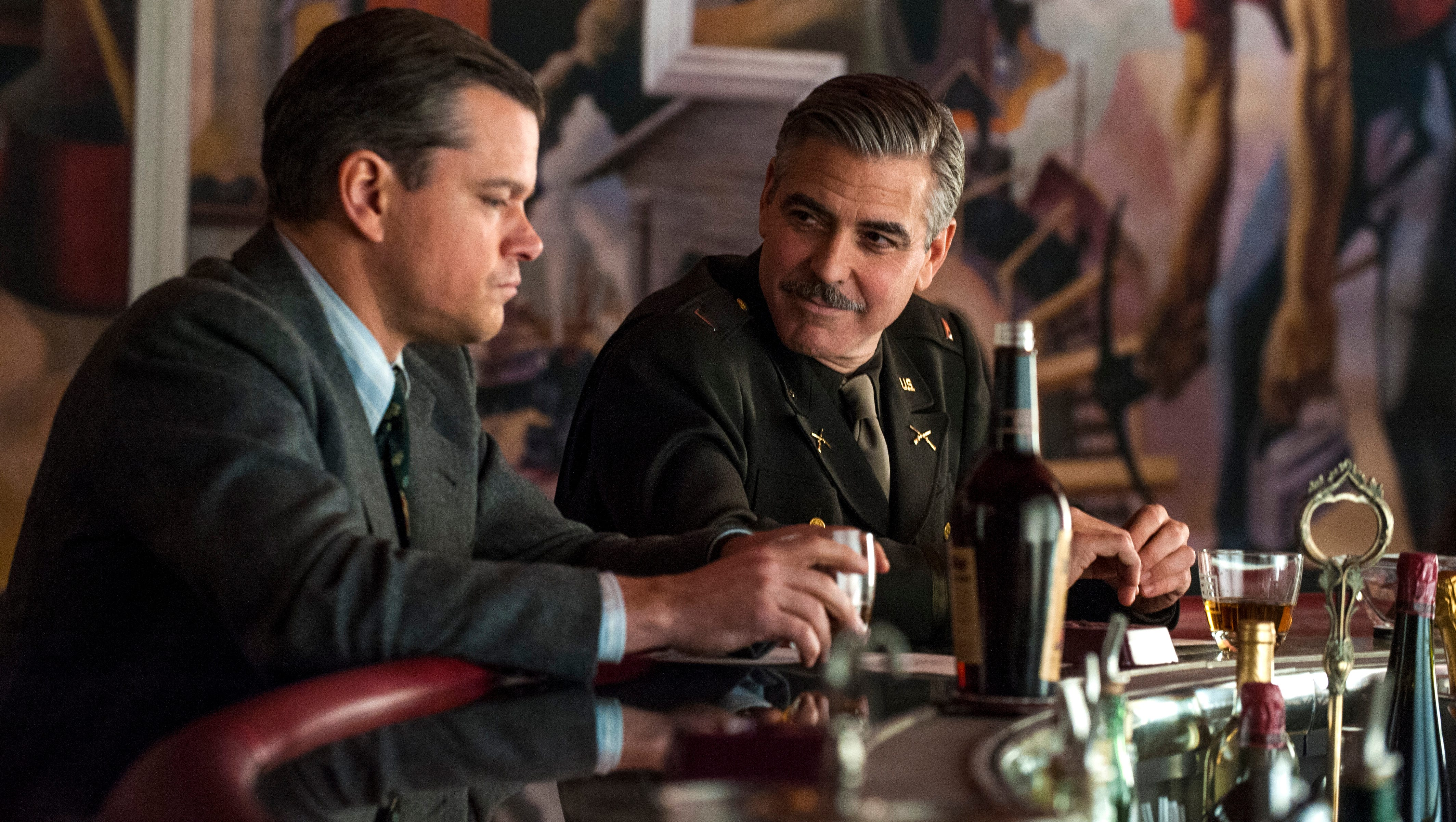 "Matt Damon, left, and George Clooney re-team for 'The Monuments Men.' The movie takes Clooney back behind the camera. ""I certainly like directing more than acting,"" he says. ""And I like writing as much as directing."""