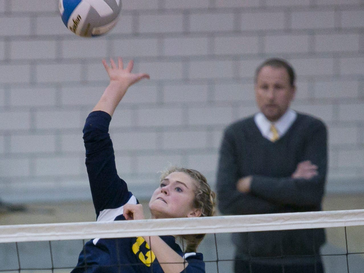 Port Huron Northern sophomore Sammi Klink spikes the ball during a volleyball game Tuesday, October 27, 2015 at Port Huron Northern High School.