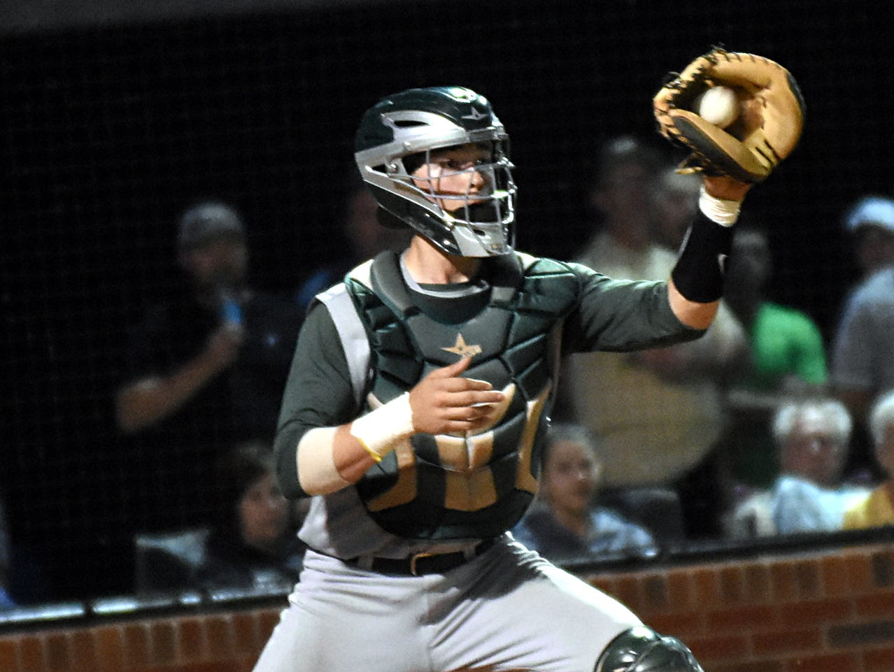 Gallatin High junior catcher Bailey Russell receives a fifth-inning throw that resulted in a forceout at home plate.