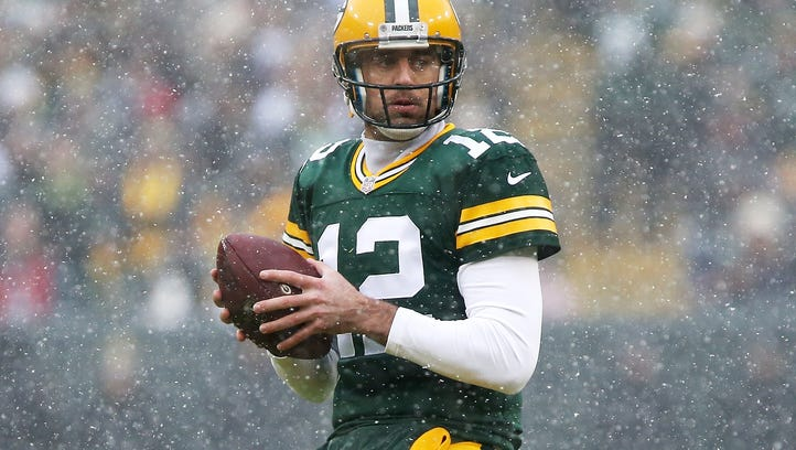Green Bay Packers quarterback Aaron Rodgers drops back