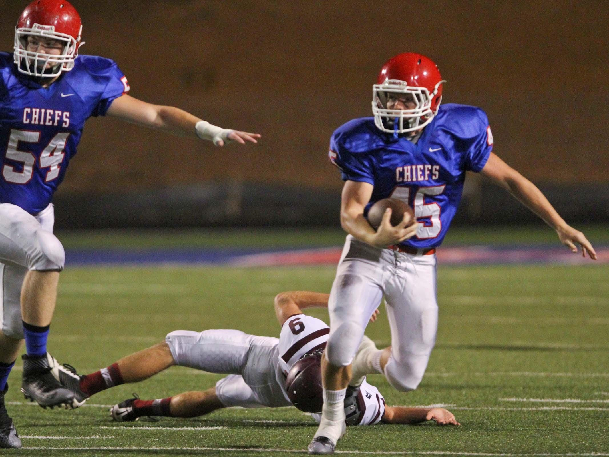 Andrew Lockhart (45) runs over a Grant Cougar and runs for a touchdown during the second quarter of the game.