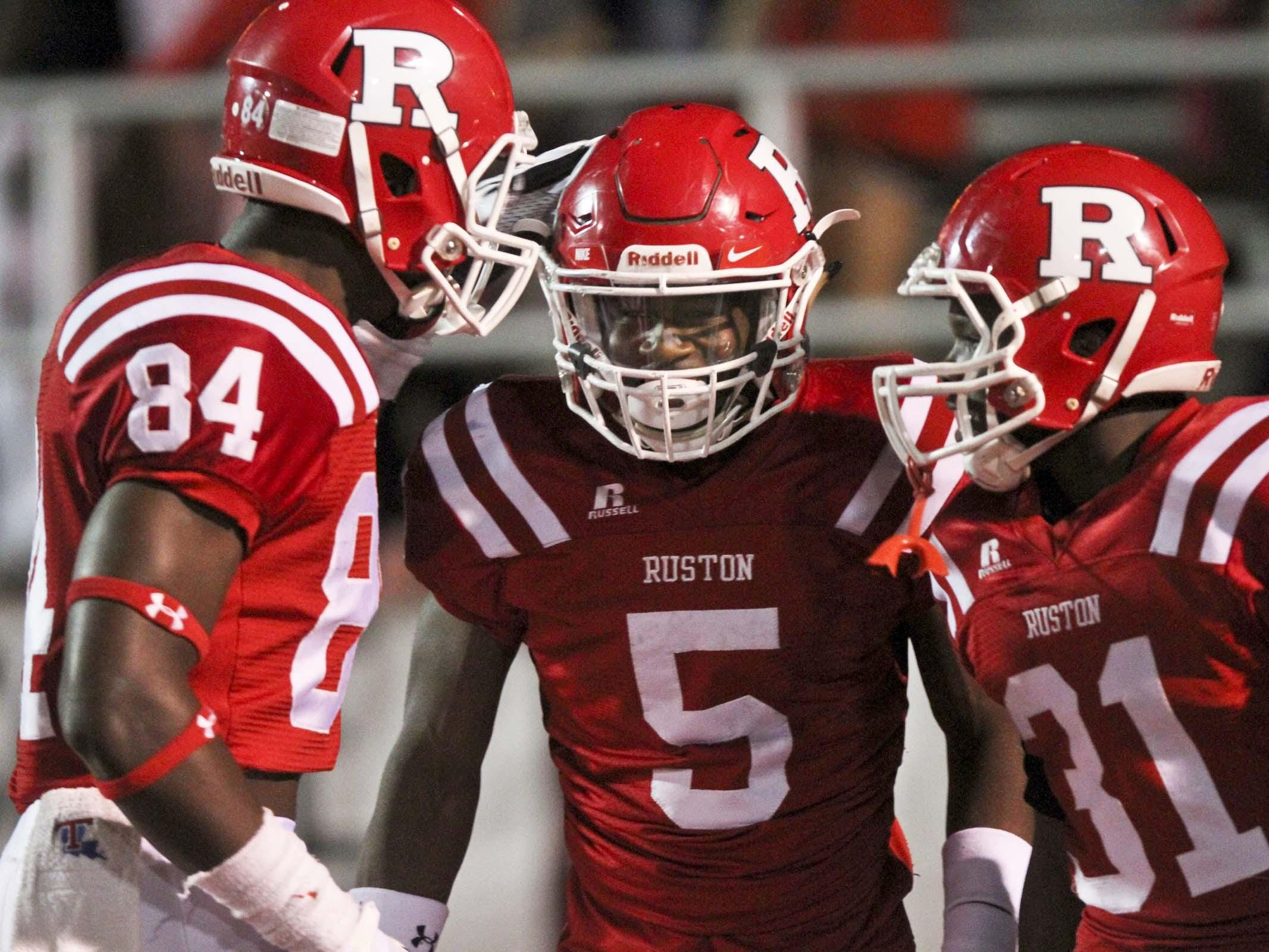 Ruston's Qay'shon Thuruman (5) is congratulated by Jeremy Brown (84) and Sontus Mitchell (31) during a game against Pineville.