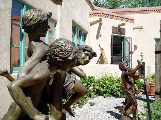 Art on display in Santa Fe's Canyon Road neighborhood. Canyon Road is home to more than 100 fine art galleries and studios that welcome visitors for free.
