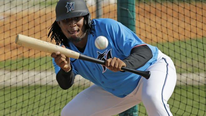 Miami Marlins pitcher Sixto Sanchez run drills during spring training baseball practice Wednesday in Jupiter, Fla.