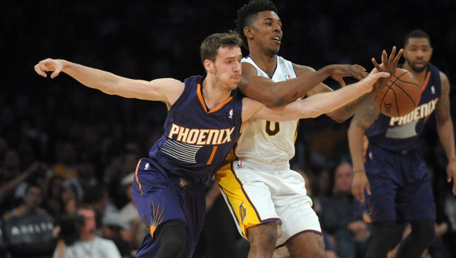 Suns guard Goran Dragic (1) and Los Angeles Lakers guard Nick Young (0) battle for the ball at Staples Center.