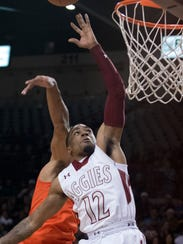 New Mexico State's AJ Harris goes hard to the rim,