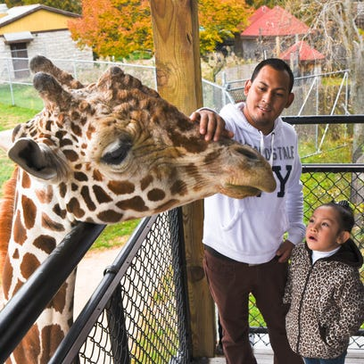 Humberto Yanez and his daughter Ashley visit with Hodari,