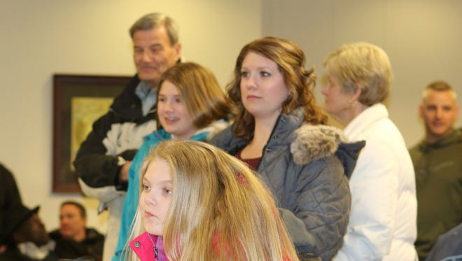 Lexi Branner, the granddaughter of Middletown Mayor Kenneth Branner (background), waits for election officials to count the votes Monday night after the polls closed in the general election. Also pictured are Laurie (mom), Maddie, Nancy (grandmother) and the mayor.