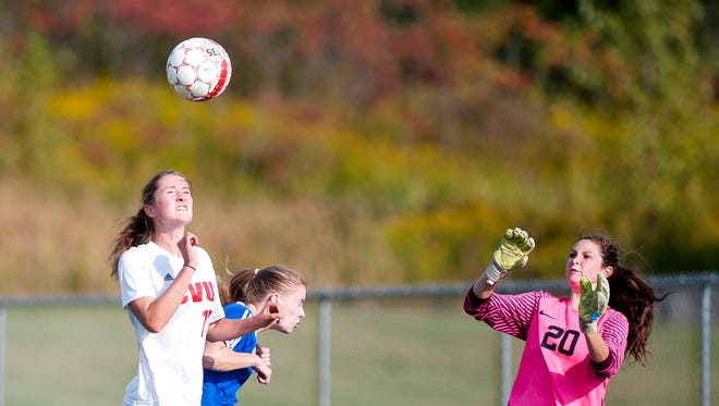 Champlain Valley's Sydney Jimmo, left, leaps to win a header against Colchester's Gabby Gosselin, right, during Wednesday's girls soccer game in Hinesburg.