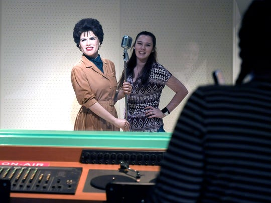Visitors can pose with wax figures like that of Patsy Cline in a recording studio at Madame Tussauds Nashville attraction.