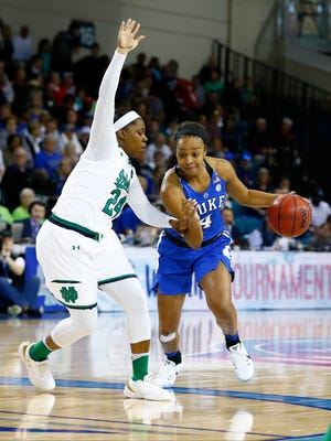 Duke Blue Devils guard Lexie Brown (4) drives the ball around Notre Dame Fighting Irish guard Arike Ogunbowale (24) in the first half during the women's ACC Conference Tournament at HTC Center.