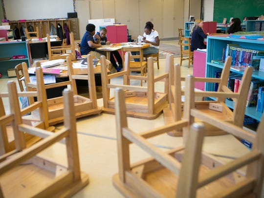 Fourth- and fifth-grade students work on various subjects at Montessori Academy at Christina.