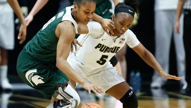 Miracle Gray of Purdue tries to steal the ball from Shay Colley of Michigan State Saturday, February 24, 2018, at Mackey Arena. Purdue fell to Michigan State 82-68.