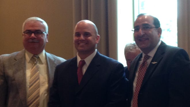 Beverly Hills Police Lt. Howard Shock (center) with Michigan Supreme Court Justice David Viviano (right) and Troy Police Chief Gary Mayer at the SPSC graduation ceremony.