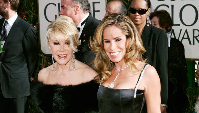 Joan and Melissa Rivers pose on the red carpet at the Golden Globe Awards in 2005.