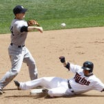 New York Yankees second baseman Stephen Drew makes the throw to first base to turn a double play after forcing the Minnesota Twins' Brian Dozier at second during the sixth inning Sunday in Minneapolis.
