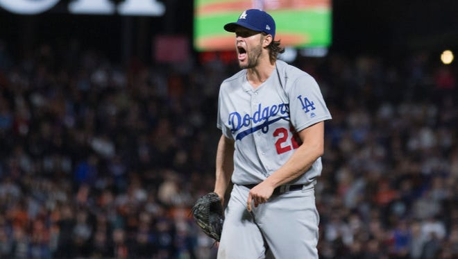 Los Angeles Dodgers starting pitcher Clayton Kershaw (22) reacts after striking out San Francisco Giants catcher Tim Federowicz with the bases loaded during the sixth inning at AT&T Park.