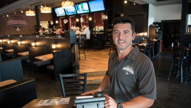 Mike Lucaj and partner Mario Lucaj, have opened the Grand Tavern in the space once occupied by Max & Erma's in the Laurel Park Place mall.