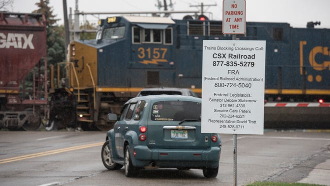 A car is blocked after a CSX train was idle for nine hours at a Plymouth intersection.