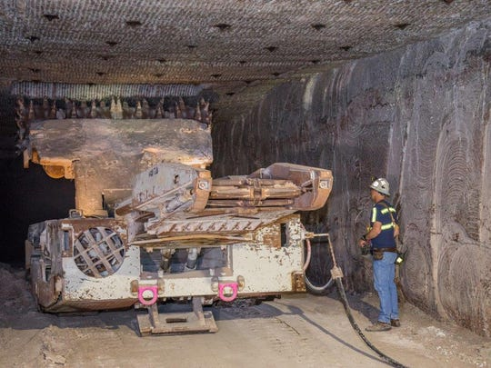 A continuous miner cuts into the salt in the underground mine of the Waste Isolation Pilot Plant, Jan. 15 at WIPP.