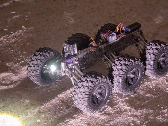 A robot built by Carlsbad High School students lights