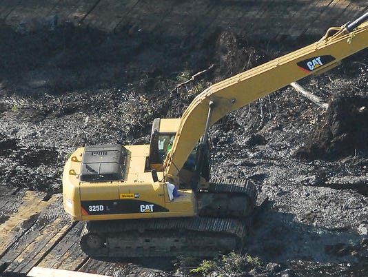 Pipeline exposed: Enbridge cleans up spill site