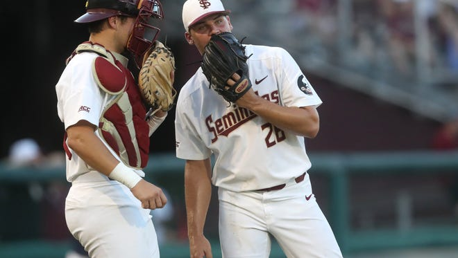 FSU's Cole Sands talks to catcher Cal Raleigh against Samford during their NCAA Regional game at Dick Howser Stadium in Tallahassee, Fla. On Friday, June 1, 2018.