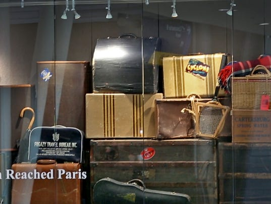"""Local artist Kipp Normand's """"When Lindbergh Reached Paris"""" exhibit at the Indianapolis International Airport, coincides with the new Paris-to-Indy flight."""