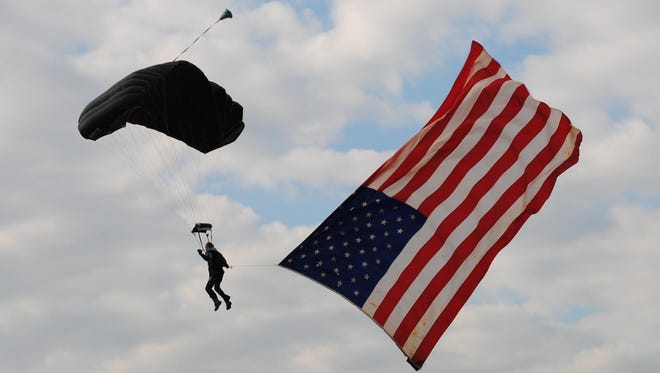 StateSkydiver carrying an American flag.