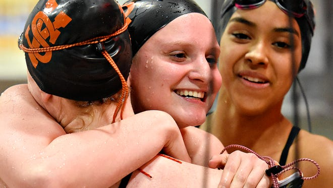 York Suburban's Carson Gross, seen here celebrating after winning the 100-yard freestyle during action earlier this season, is hoping to add more state hardware this weekend at the PIAA Class AA Girls' Swimming Championships at Bucknell. She is the defending 200 freestyle champion.