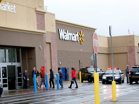 Shoppers walk into Walmart in Horseheads around 12:50
