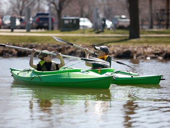 Bryce and Dakota Britton of Eldorado ride in kayaks