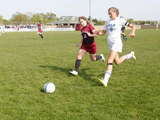 Mayville's Breanna Cisewski races for the ball against
